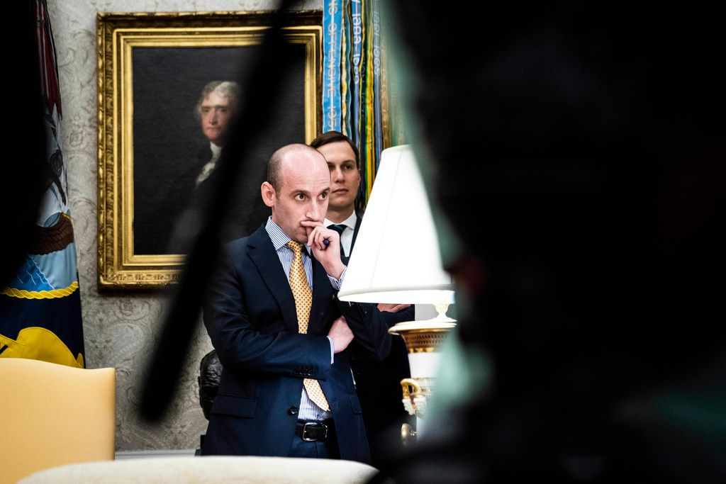 """White House advisers Stephen Miller (left) and Jared Kushner listen as President Donald Trump speaks in the Oval Office as Guatemala signs a """"safe third country"""" agreement to restrict asylum applications to the U.S. from Central America in July."""