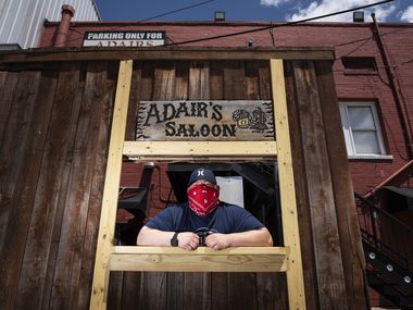 Owner Joel Morales of Adair's Saloon poses at his drive-through window on Sunday, July 19, 2020, in Dallas.