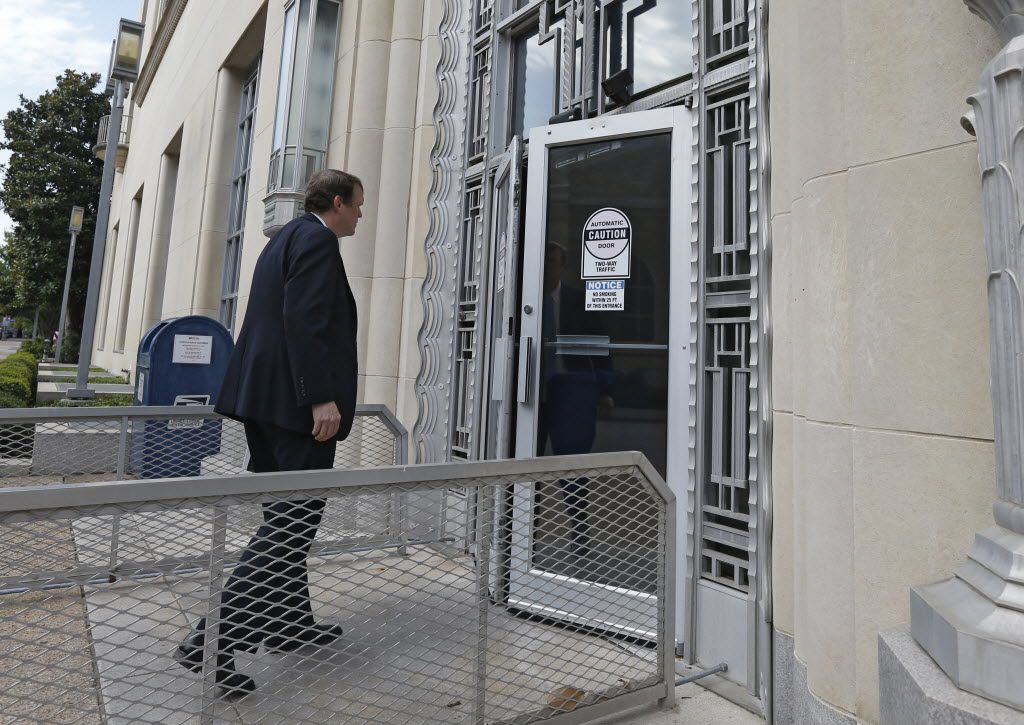 Jeff Mateer, first assistant to the Texas attorney general, walks into a courtroom. Some senators are pushing back against President Donald Trump's nomination of Mateer to a federal court.