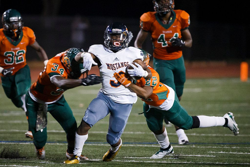 Sachse running back Myles Nash (3) is brought down by Naaman Forest's Adrian Brown (34) and DJ White (22) during a game on Nov. 2, 2017.