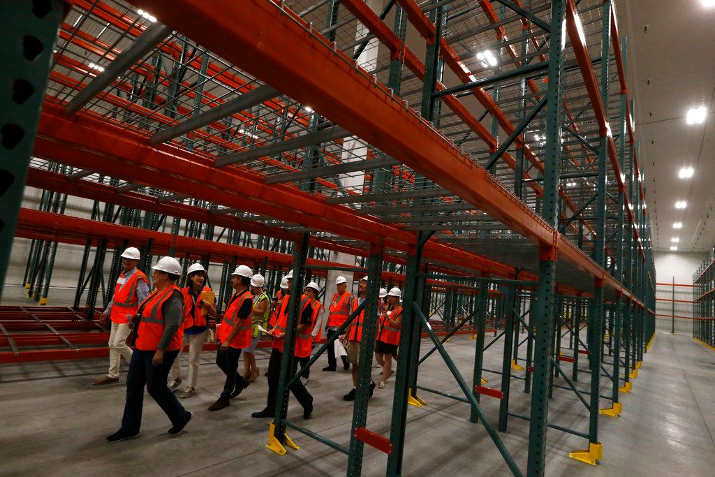 A group takes a tour of the refrigerated storage area at the new North Texas Food Bank in Plano.