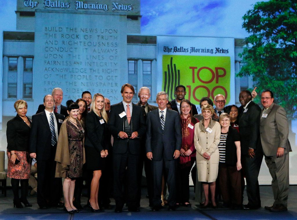 Publishing Concepts poses for a group photo with Jim Moroney, Publisher and CEO of the Dallas Morning News, (fourth, front row) after wining the number one midsize company to work for at the Top 100 Place to Work luncheon at the Dallas Omni Hotel on Friday, November 17, 2016 in Dallas, Texas. (David Woo/The Dallas Morning News)