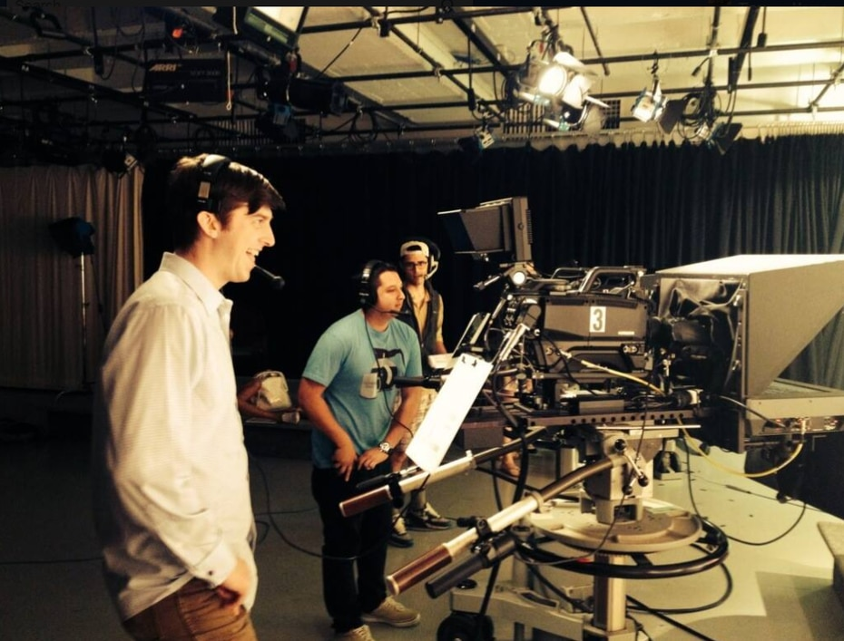 Trevor Cadigan (left) behind the camera at SMU.