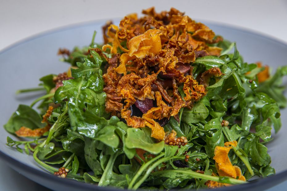 Lada has three salads on the menu. The Arugula and Carrot salad comes with agave-infused grapes, pickled mustard seeds and carrots two ways: roasted and crispy. It's drizzled with charred citrus vinaigrette.