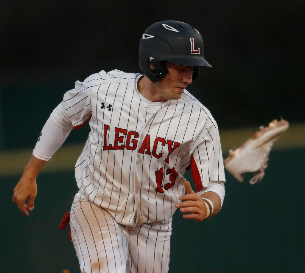 Mansfield Legacy's Nathan Rooney (13) loses a shoe but not a step as he sprints to third base during the second inning of a 16-0 win over Arlington Sequin. (Steve Hamm/ Special Contributor)