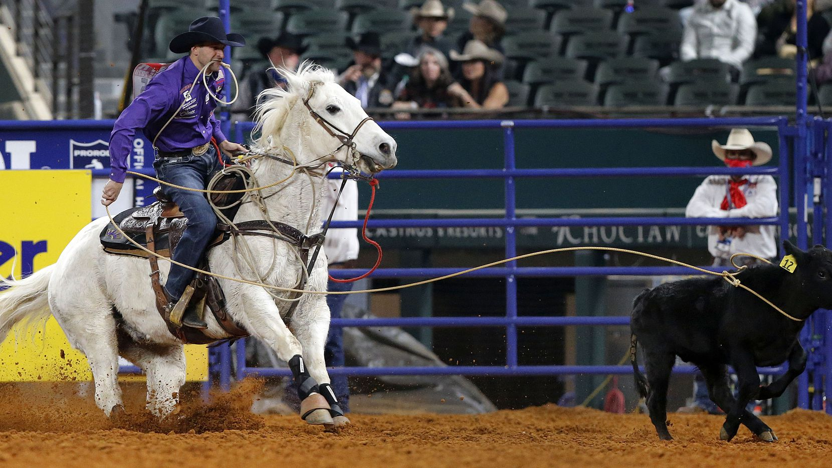 Tie-Down Roper Shane Hanchey of Sulpher, La., lassoes a calf in Round 10 of the National Finals Rodeo at Globe Life Field in Arlington, Dec. 12, 2020. Our editorial board thinks North Texas should tie up a contract with the rodeo as soon as possible. (Tom Fox/The Dallas Morning News)
