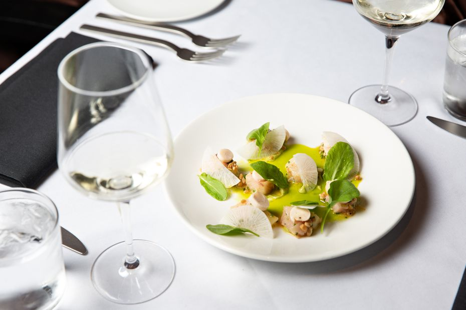 Cured hamachi crudo is a new dish at Dakota's Steakhouse, created by executive chef Ji Kang. It's a raw fish dish with heart of palm, Asian pears, white radish, pine nut vinaigrette and avocado puree.