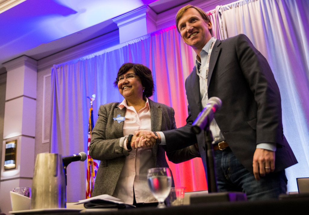Democratic gubernatorial candidate and former Dallas Sheriff Lupe Valdez ( left) shook hands with fellow candidate Andrew White of Houston after they participated in a one-on-one debate at the Texas AFL-CIO COPE Convention in January. The two will face off in a runoff election in May.