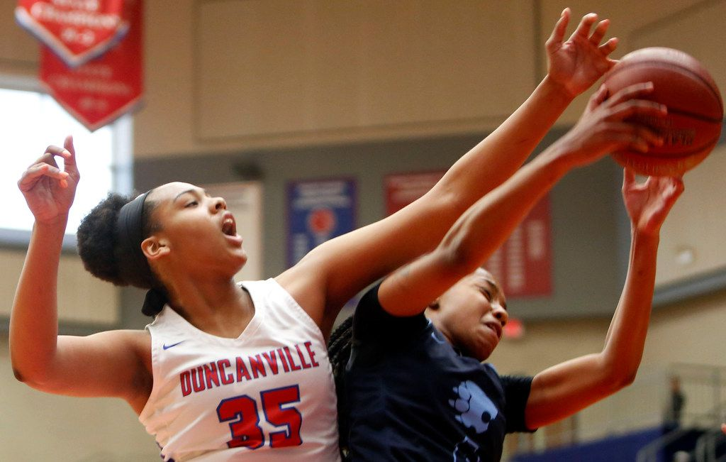 Duncanville post player Hannah Gusters (35) battles Anaya Boyd from Lovejoy (Ga.) for a rebound during a game in the Thanksgiving Hoopfest on November 24, 2018. (Steve Hamm/ Special Contributor)