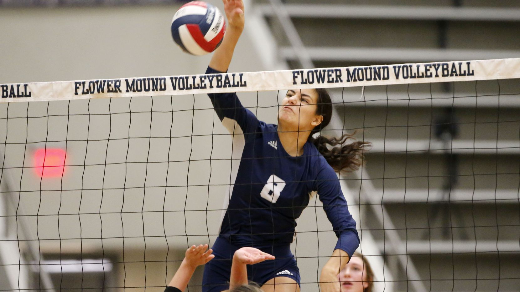 Flower Mound's Bella Ortiz (8) records a kill during Tuesday's 25-17, 25-18, 25-21 win over Plano West in District 6-6A. (Michael Ainsworth/Special Contributor)