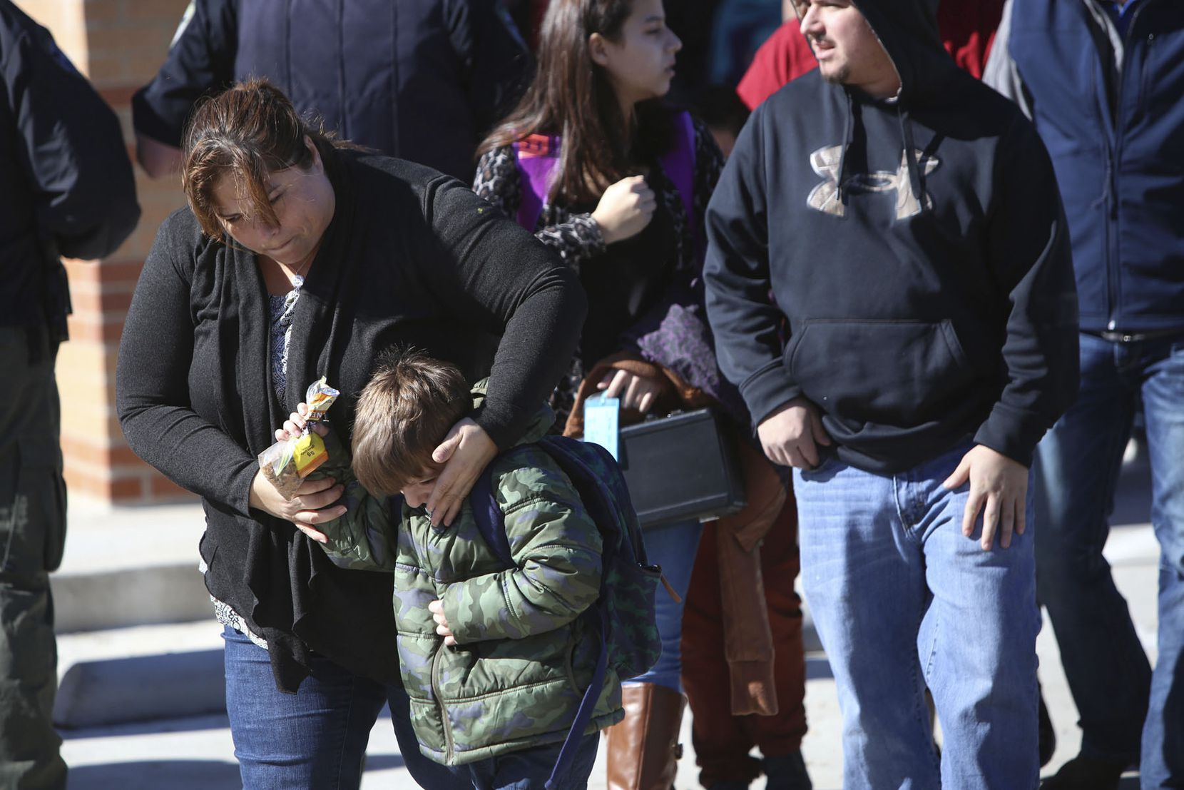 Parents pick up their children at Stafford Elementary school after a shooting at Italy High School on Monday, Jan. 22, 2018, in Italy, Texas. (Photo © Chris McGathey)