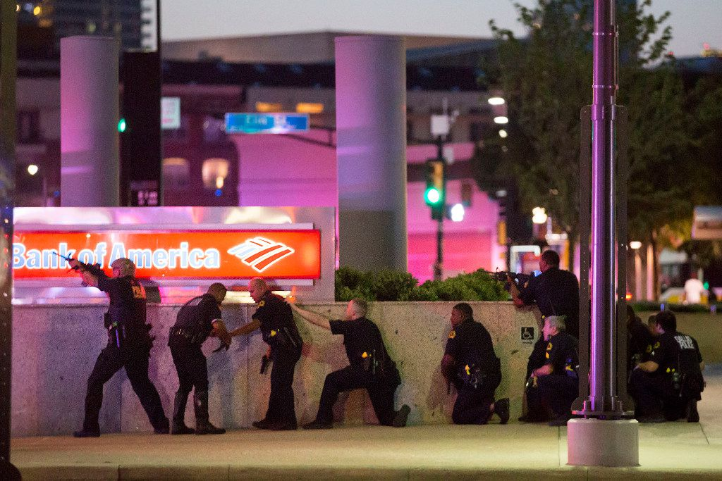 Dallas police took up positions along a wall at the corner of Lamar at Main streets as they trained their weapons on the El Centro campus at 9:04 p.m. ORG XMIT: SPNW