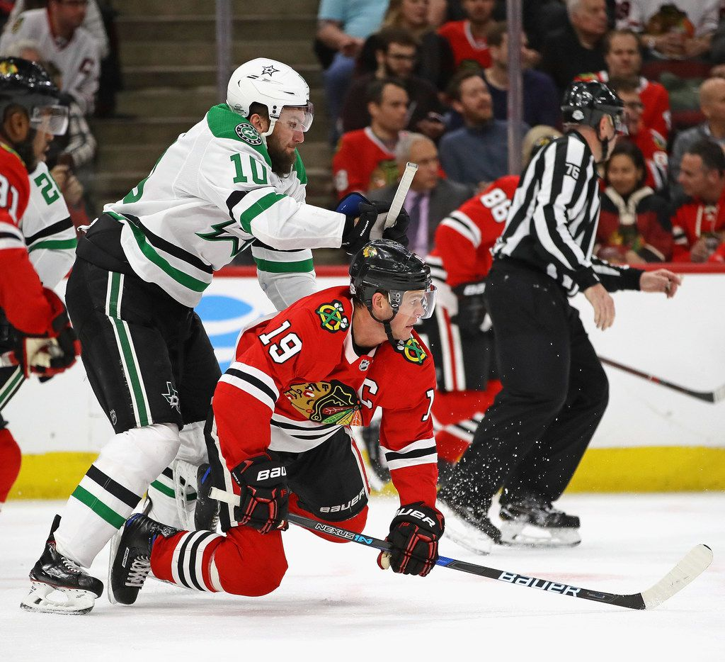 CHICAGO, IL - FEBRUARY 08:  Jonathan Toews #19 of the Chicago Blackhawks is knocked to the ice by Martin Hanzal #10 of the Dallas Stars at the United Center on February 8 2018 in Chicago, Illinois. The Stars defeated the Blackhawks 4-2. (Photo by Jonathan Daniel/Getty Images)