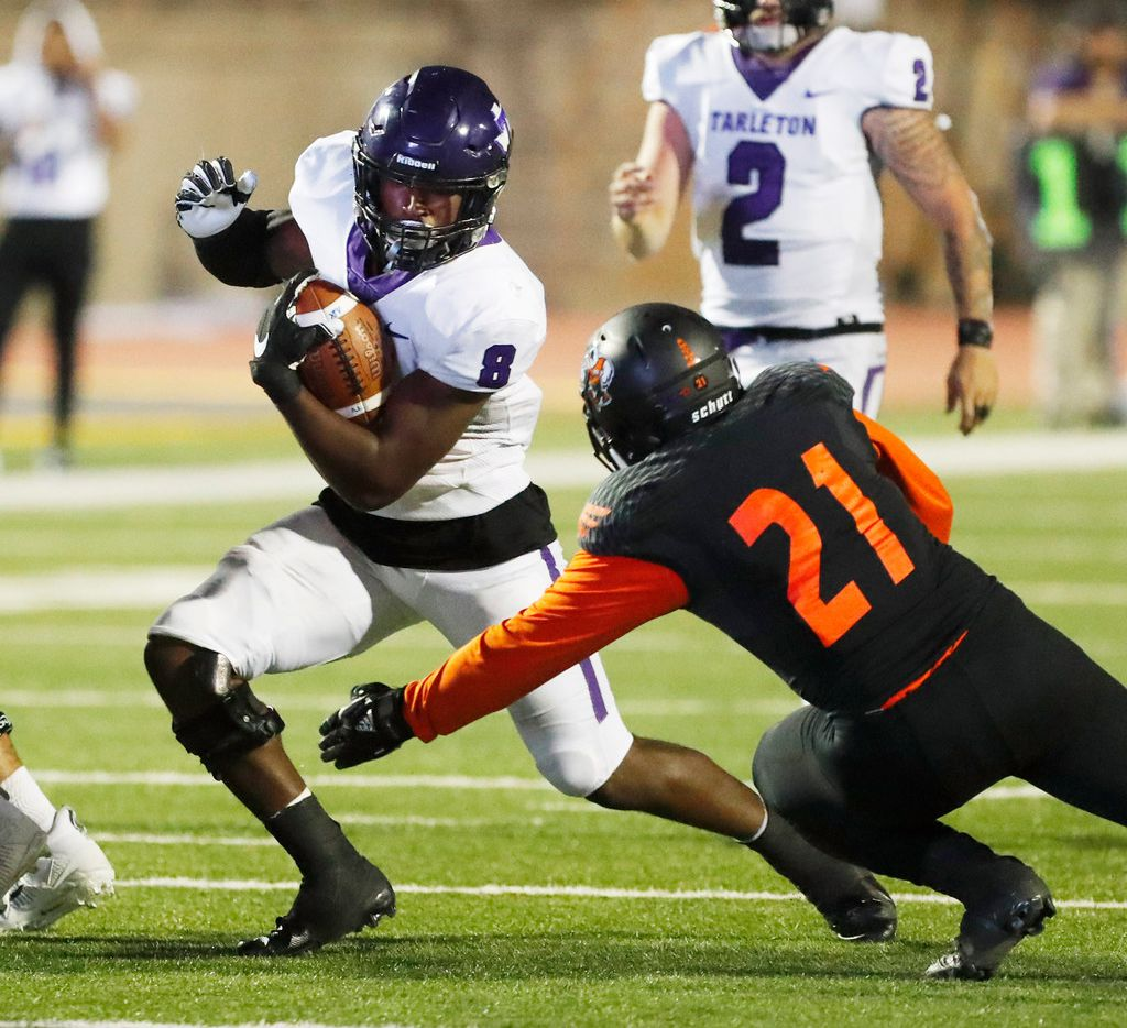 Tarleton State's Khalil Banks (8) is tackled by Texas Permian Basin's Emilio Solis (21) in the second quarter of an NCAA Division II college football game, Saturday, Sept. 28, 2019, in Odessa, Texas. (Mark Rogers/Odessa American via AP)