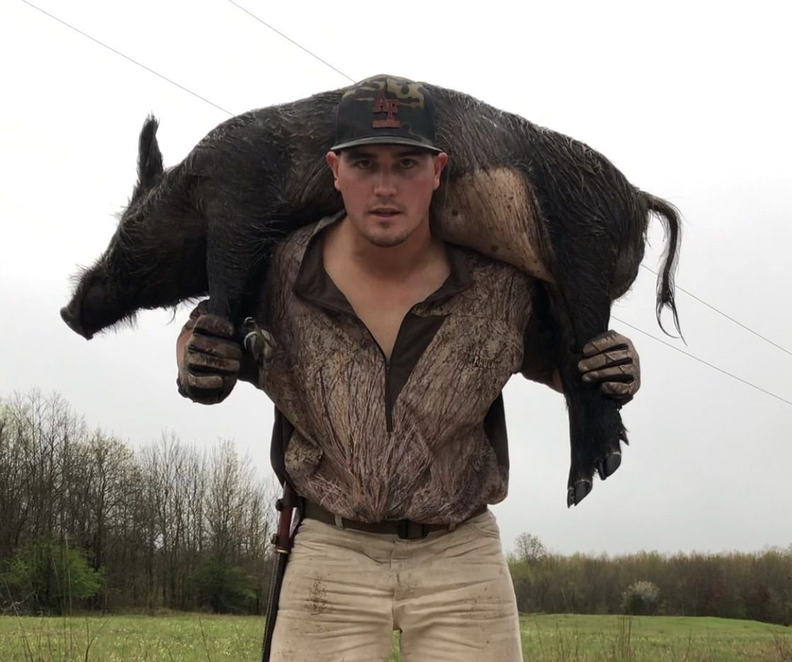 Minor league baseball player Nic Ready is pictured on March 18, 2020 outside Talco, Texas, carrying a 150-pound hog he killed. Ready, a former Jesuit baseball player, is currently in the Miami Marlins' system.