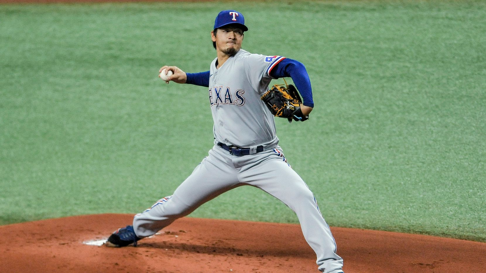 Texas Rangers starter Kohei Arihara pitches to a Tampa Bay Rays batter during the first inning of a baseball game Wednesday, April 14, 2021, in St. Petersburg, Fla. (AP Photo/Steve Nesius)