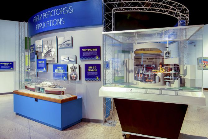 A scale model of a nuclear power plant and an atomic-powered merchant ship sit on display at the National Museum of Nuclear Science and History.  This museum offers a glowing look at the history of atomic work, weaponry, medicine and power.