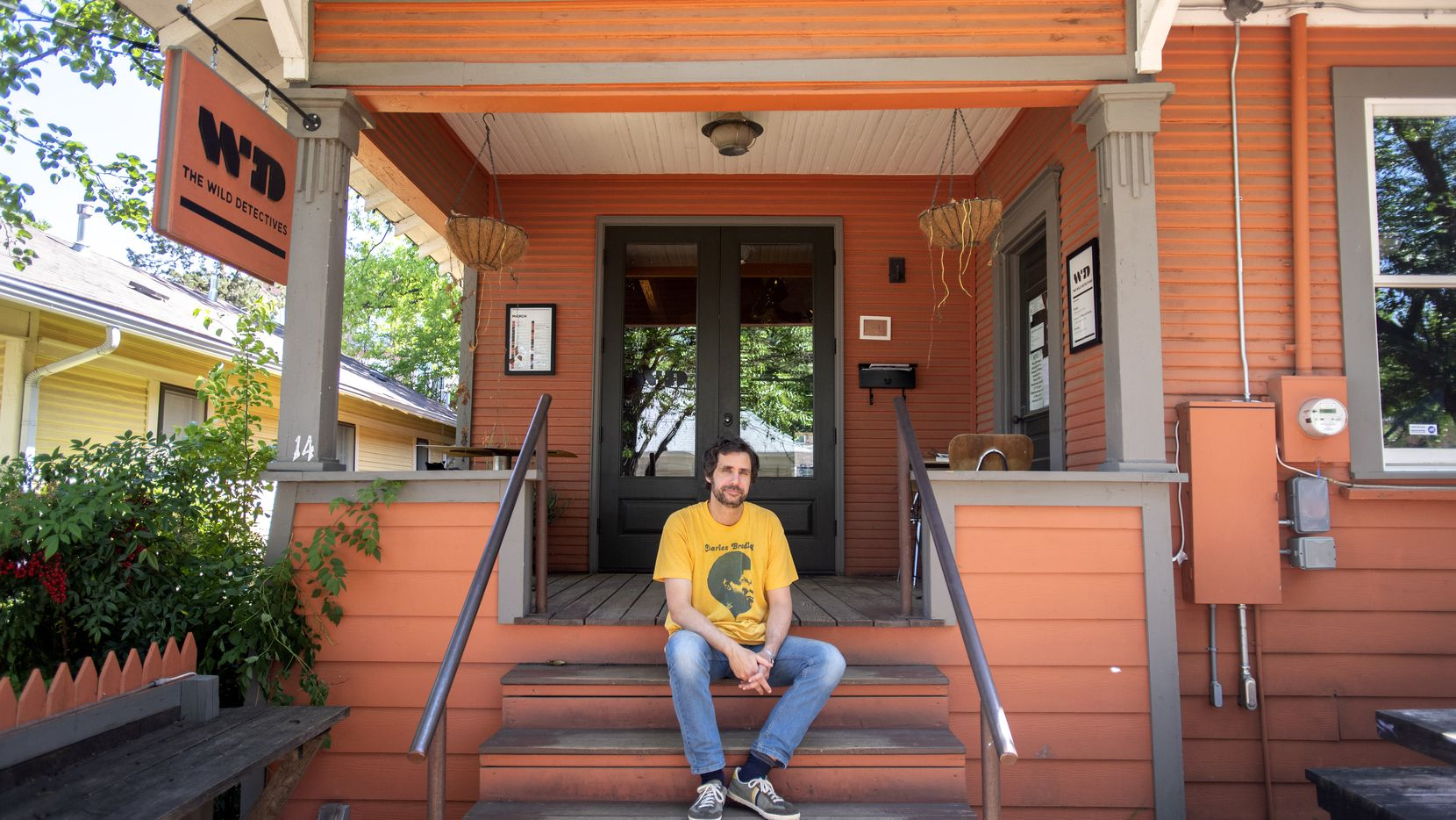 Javier Garcia del Moral, owner of The Wild Detectives bookstore and bar, poses for a portrait outside his quiet shop, April 29, 2020 in the Bishop Arts District in Dallas.