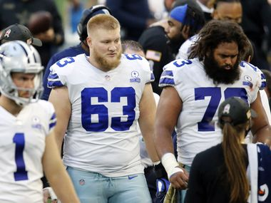 Dallas Cowboys center Tyler Biadasz (63) is pictured on the sideline next to fellow center Joe Looney (73) who started against the Pittsburgh Steelers at AT&T Stadium in Arlington, Texas Sunday, November 8, 2020.