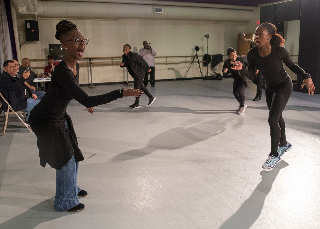 Michelle N. Gibson, left, directs Dallas Black Dance Theatre in a rehearsal of her new piece, Displaced, Yet Rebirthed.