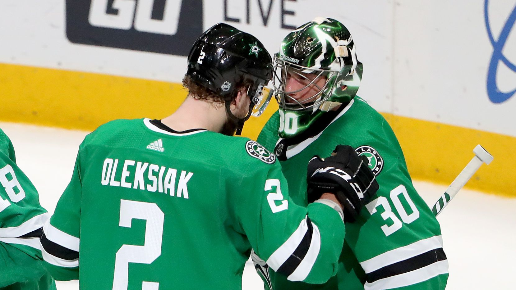 Ben Bishop #30 of the Dallas Stars celebrates with Jamie Oleksiak #2 of the Dallas Stars after the Dallas Stars beat the Arizona Coyotes 3-2 at American Airlines Center on February 19, 2020 in Dallas, Texas.