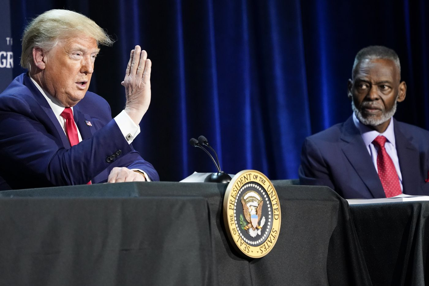 President Donald Trump speaks as Bishop Harry Jackson, senior pastor of Hope Christian Church, listens at right, during a roundtable conversation about race relations and policing at Gateway Church Dallas Campus on Thursday, June 11, 2020, in Dallas. (Smiley N. Pool/The Dallas Morning News)