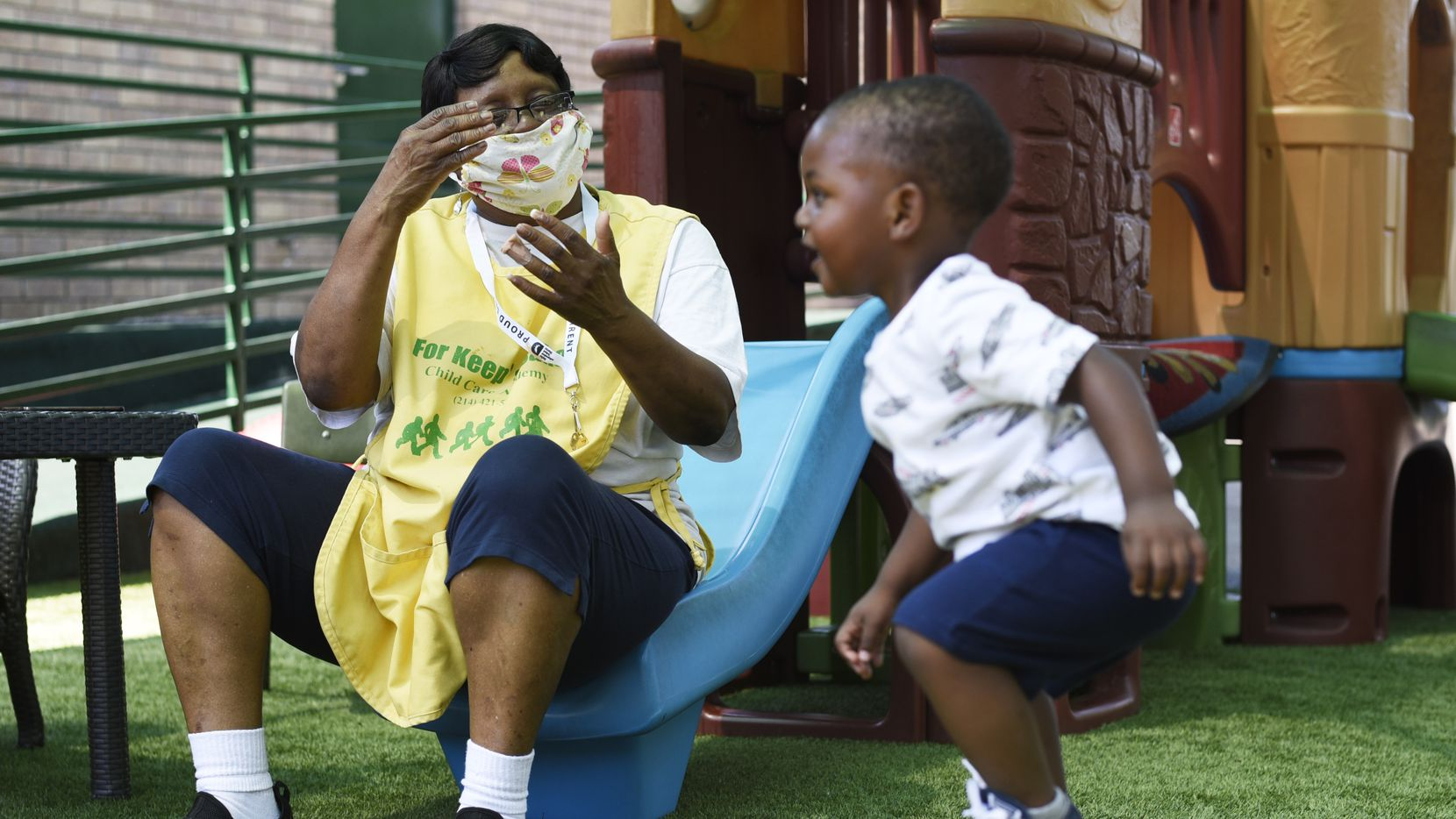 Jeri Lowe, left, a 2-year-old teacher, sings a song as a young boy dances by jumping up and down to her words, during his stay at For Keep's Sake Child Care Academy in Dallas, Tuesday May 19, 2020. Ben Torres/Special Contributor