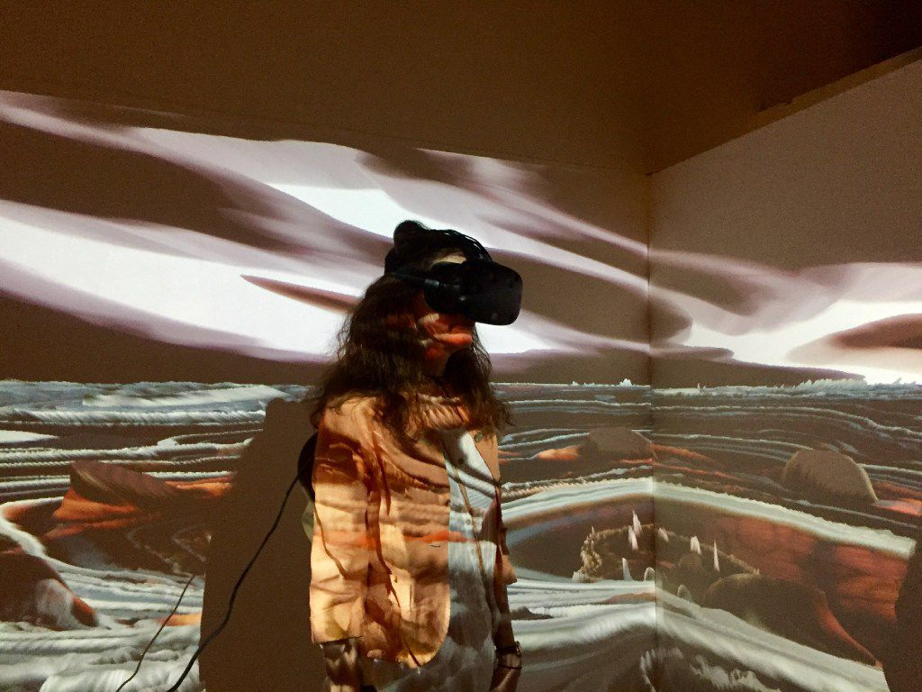 A patron at the 2017 Currents New Media Festival in Santa Fe experiences Vesica Pisces, 2017, a VR collaboration by NoiseFold, a creative group consisting of UNT professor David Stout and Cory Metcalf with contributor Reilly Donovan.