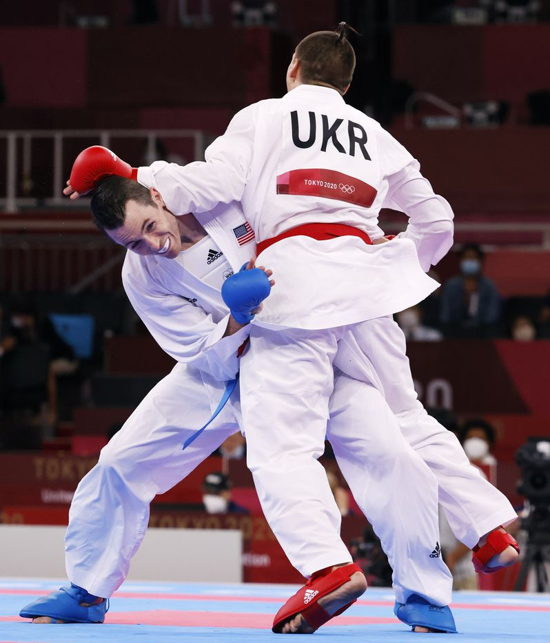 USA's Tom Scott competes against Ukraine's Stanislav Horuna during the karate men's kumite -75kg elimination round at the postponed 2020 Tokyo Olympics at Nippon Budokan, on Friday, August 6, 2021, in Tokyo, Japan. Scott defeated Harspataki 8-3. Scott finished in fourth place in his pool and did not advance to the next round. (Vernon Bryant/The Dallas Morning News)