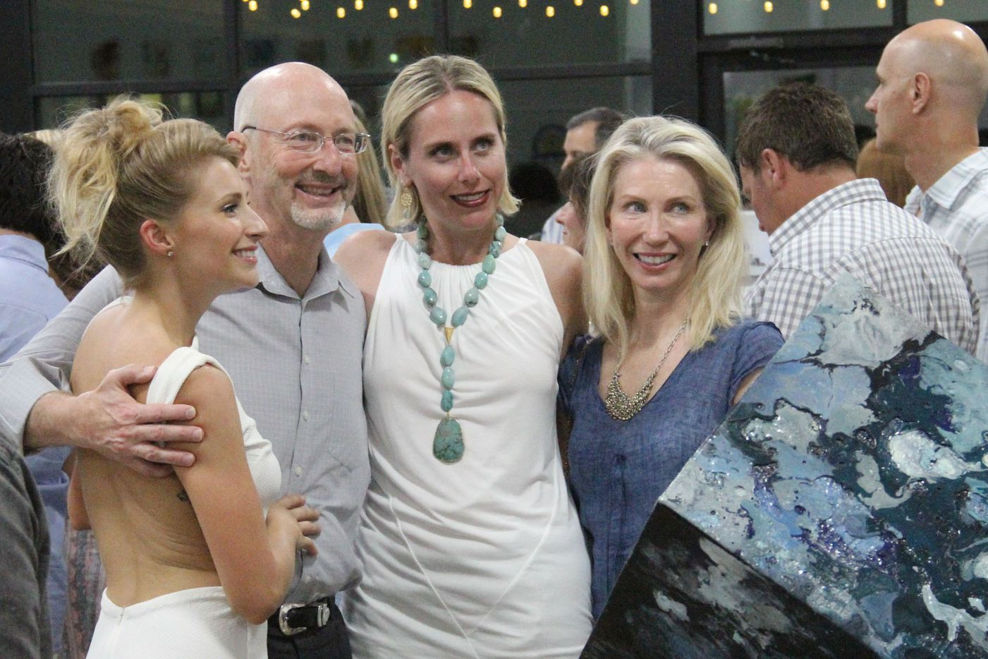Artist Toni Martin posed with friends at the Random Art Gallery opening reception of her art exhibit.