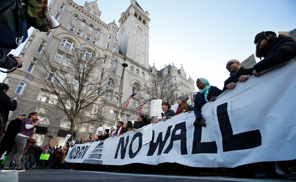 Protesters march along Pennsylvania Avenue past the Trump International Hotel during a rally protesting the immigration policies of President Donald Trump, Saturday, Feb. 4, in Washington, D.C.. (Manuel Balce Ceneta/AP)