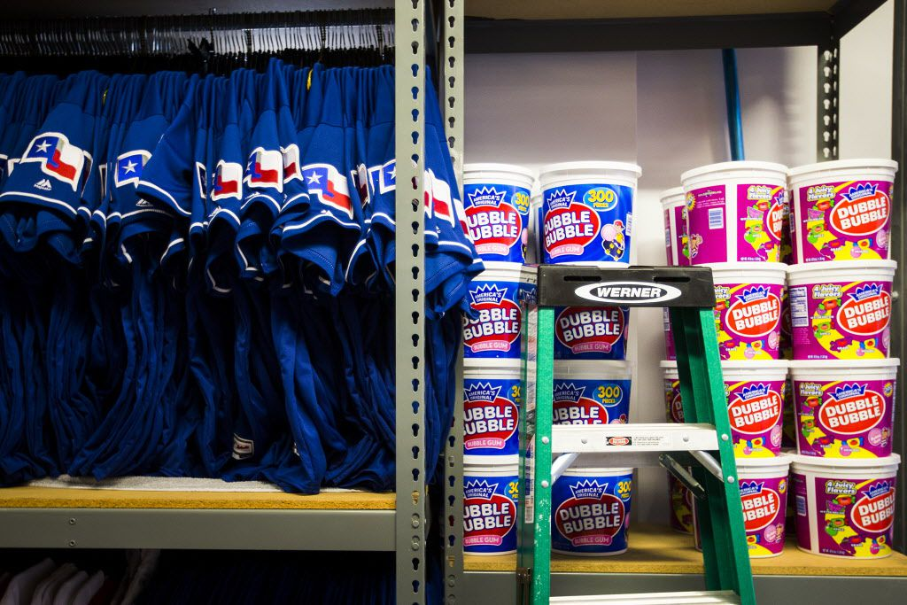 Jerseys and tubs of bubble gum fill shelves in the equipment room at Texas Rangers newly renovated spring training facility during a media tour on Thursday, Feb. 18, 2016, in Surprise, Ariz. (Smiley N. Pool/The Dallas Morning News)