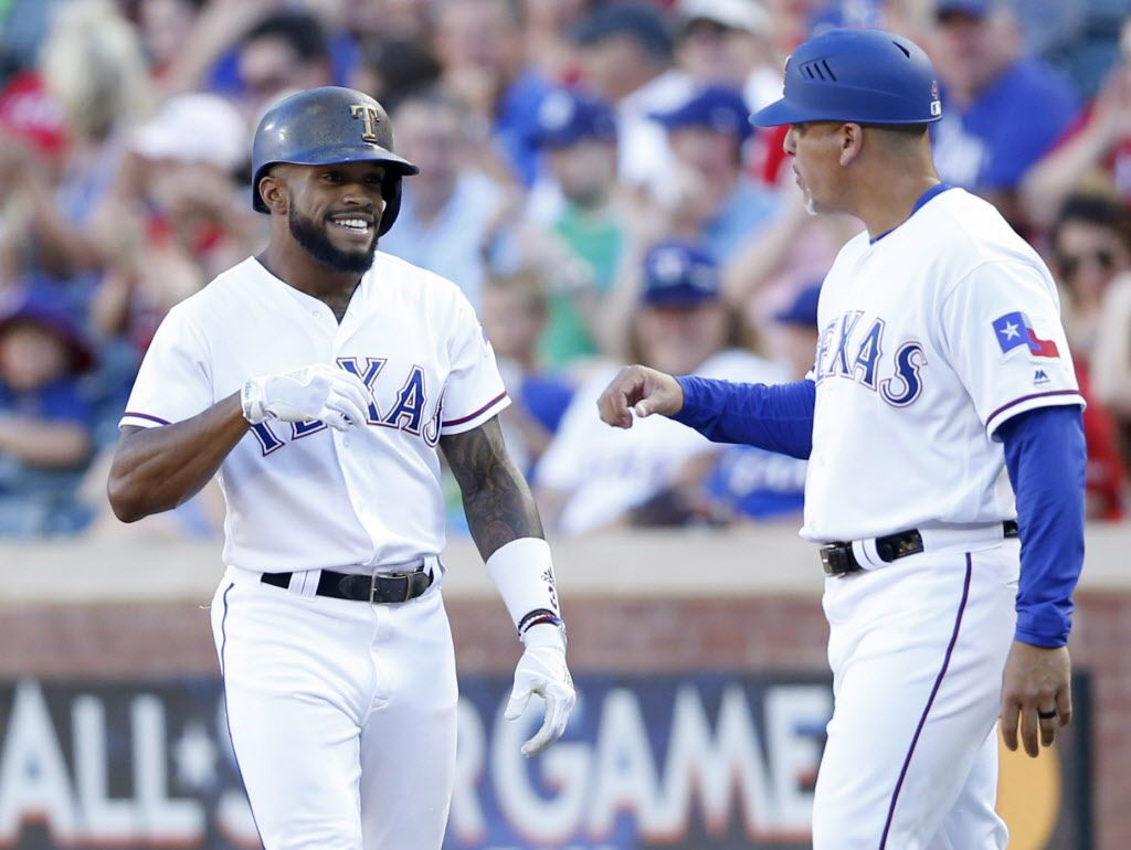 Texas Rangers left fielder Delino DeShields (3) and Texas Rangers first base coach Hector Ortiz (4) celebrate after DeShields safely makes it to first base off a bunt from a pitch by Toronto Blue Jays starting pitcher Francisco Liriano (45) during the first inning of play at Globe Life Park in Arlington on Tuesday, June 20, 2017. (Vernon Bryant/The Dallas Morning News)