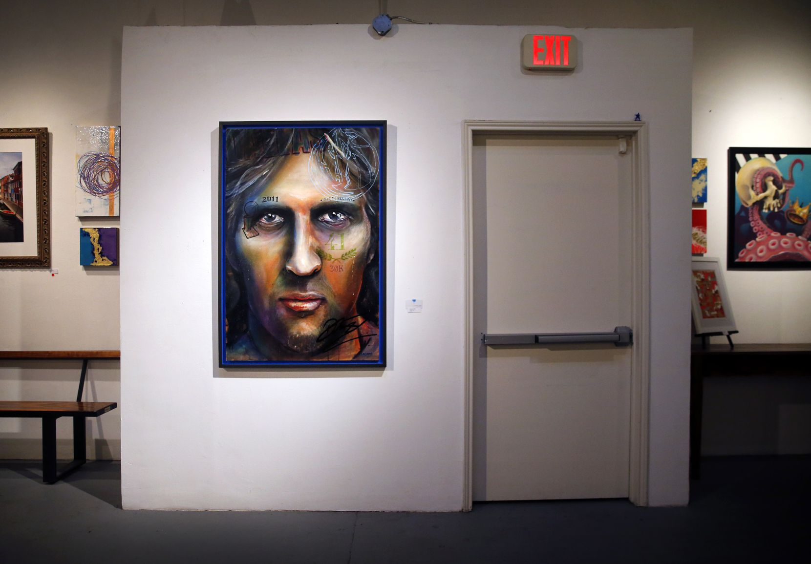 As the All-Star nears retirement after 21 seasons in the NBA, Dirk Nowitzki is featured in a painting titled Need A Light by artist Brandon Adams. It was hanging next to an exit at the Kettle Art Gallery in Dallas on March 29, 2019.