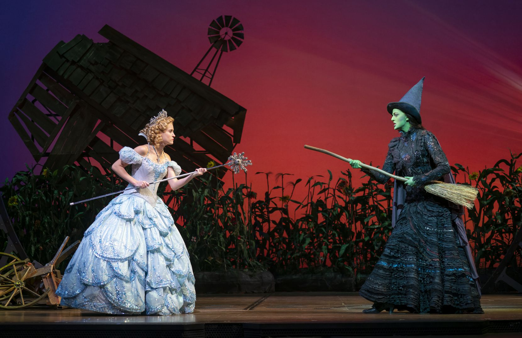 """Allison Bailey as Glinda, left, and Talia Suskauer as Elphaba in the Broadway touring production of """"Wicked,"""" a takeoff on characters from """"The Wizard of Oz."""""""