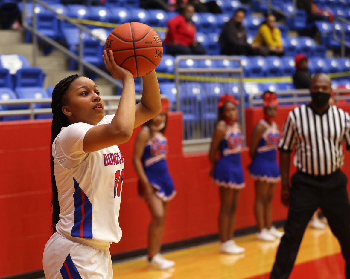 Duncanville's Hope LeMelle (00) attempts a shot in a game against Cedar Hill during the second half of play at Sandra Meadows Arena at Duncanville High School on Tuesday, January 12, 2021 in Dallas. Duncanville defeated Cedar Hill 63-42. (Vernon Bryant/The Dallas Morning News)