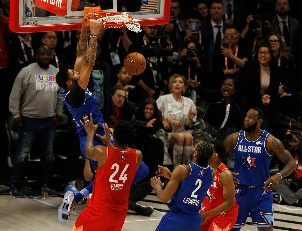 Team LeBron's Anthony Davis (2) dunks in front of Team Giannis' Joel Embiid (24) during the second half of play in the NBA All-Star 2020 game at United Center in Chicago on Sunday, February 16, 2020. Team LeBron defeated Team Giannis 157-155. (Vernon Bryant/The Dallas Morning News)