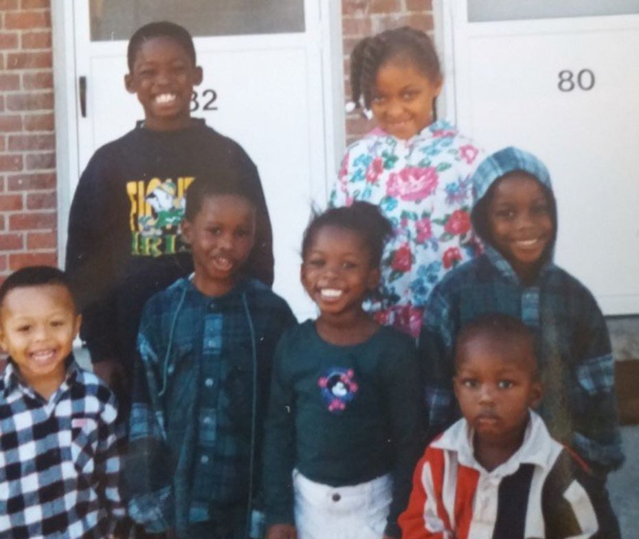"""A photo of Dorian Finney-Smith's family and friends from childhood. Top row are Finney-Smith's brother Benjamin (left) and a family friend. Front row, from left, are a family friend; brother Ra-Shawn """"Peanut"""" Finney, who was shot and killed at a neighborhood party as a high school senior; sister Sha-Kyla; and brother DaShawn, Ra-Shawn's twin. Dorian is at lower right."""
