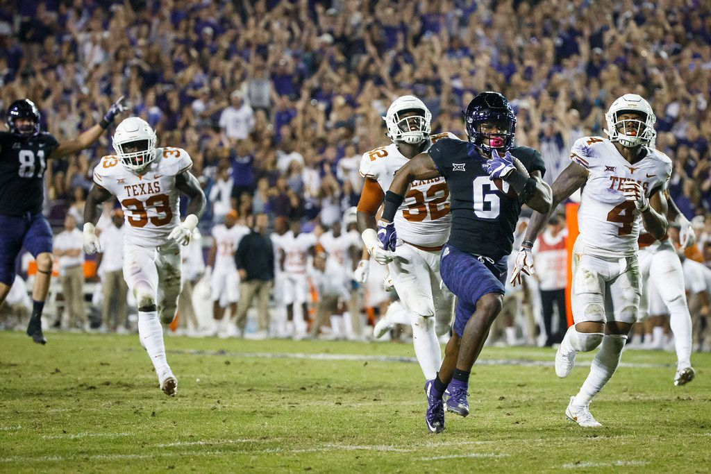 FILE - TCU running back Darius Anderson (6) breaks through the Texas defense to score on a 31-yard touchdown run during the fourth quarter of an NCAA football game at Amon G. Carter Stadium on Saturday, Nov. 4, 2017, in Fort Worth, Texas. TCU won the game 24-7. (Smiley N. Pool/The Dallas Morning News)