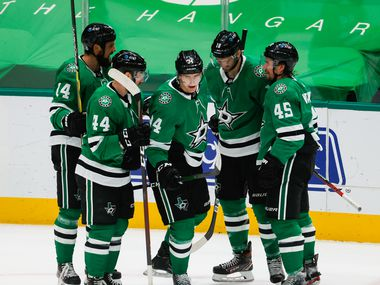 Dallas Stars players celebrate right wing Denis Gurianov (34) goal in the second period against the Columbus Blue Jackets at American Airlines Center in Dallas on Thursday, April 15, 2021.
