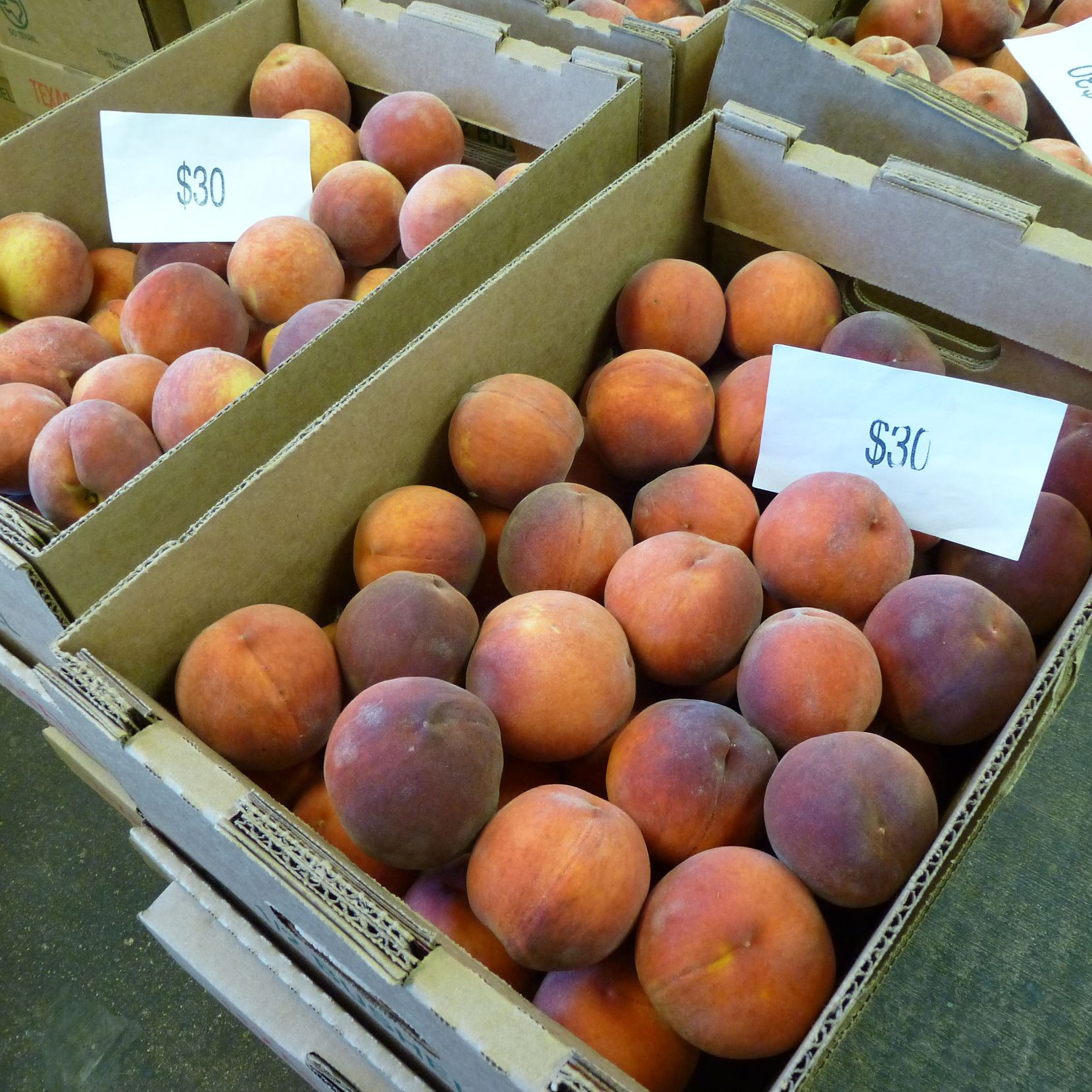 Ham Orchards sells peaches in big bags, little bags and in boxes (pictured).