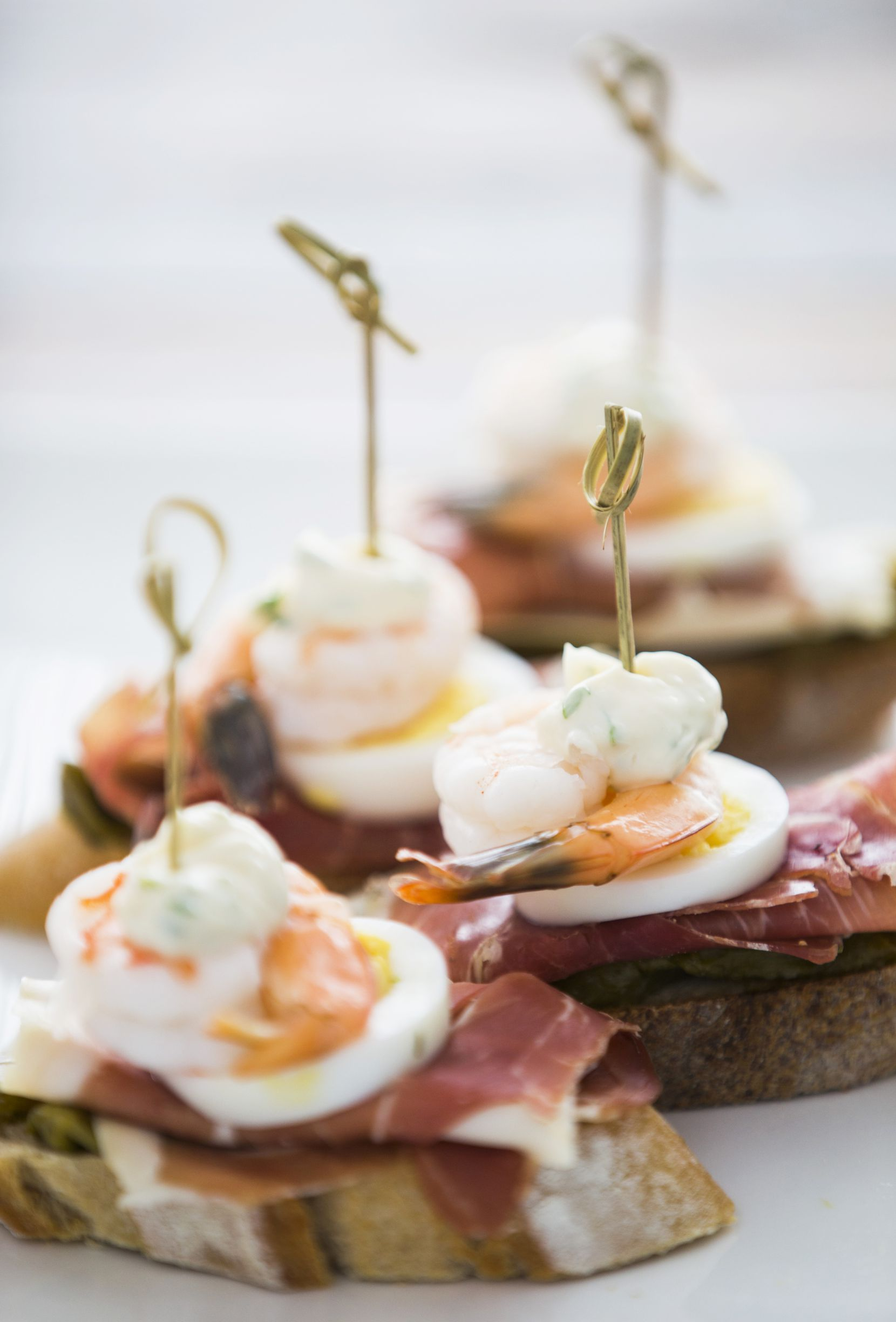 Jamon serrano with roasted peppers, egg and shrimp