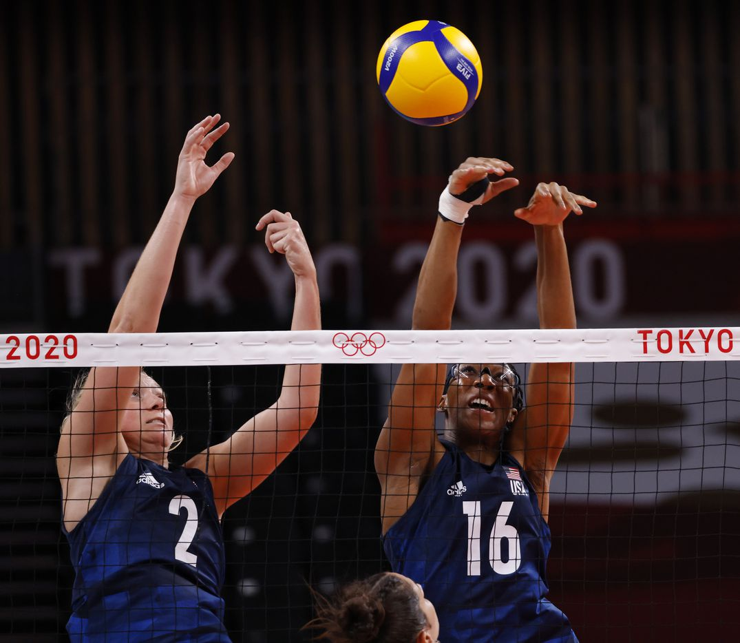 USA's Jordyn Poulter (2) and Foluke Akinradewo (16) block a ball hit by Argentina's Julieta Constanza Lazcano (11) in a women's volleyball game during the postponed 2020 Tokyo Olympics at Ariake Arena on Sunday, July 25, 2021, in Tokyo, Japan. USA defeated Argentina 3-0 (25-20, 25-19, 25-20). (Vernon Bryant/The Dallas Morning News)