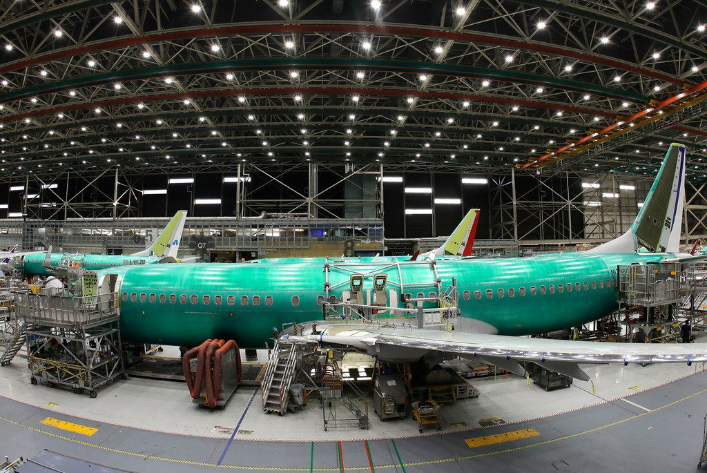 In this March 27, 2019, file photo, a Boeing 737 MAX 8 airplane is shown on the assembly line during at Boeing's 737 assembly facility, in Renton, Wash.  General Electric Co. helps make engines for the 737 Max.