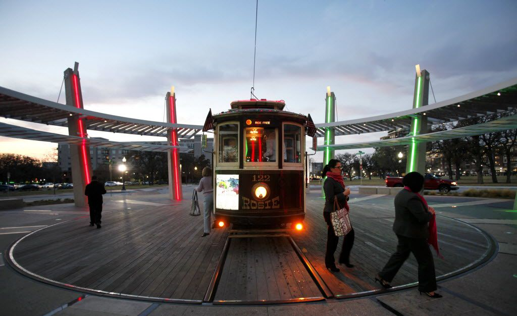 Passengers exit the McKinney Avenue trolley at the trolley turnaround near Central Expressway and enter the DART CityPlace train station during the Friday evening commute in Dallas on Friday, December 7, 2012. (Lara Solt/The Dallas Morning News)