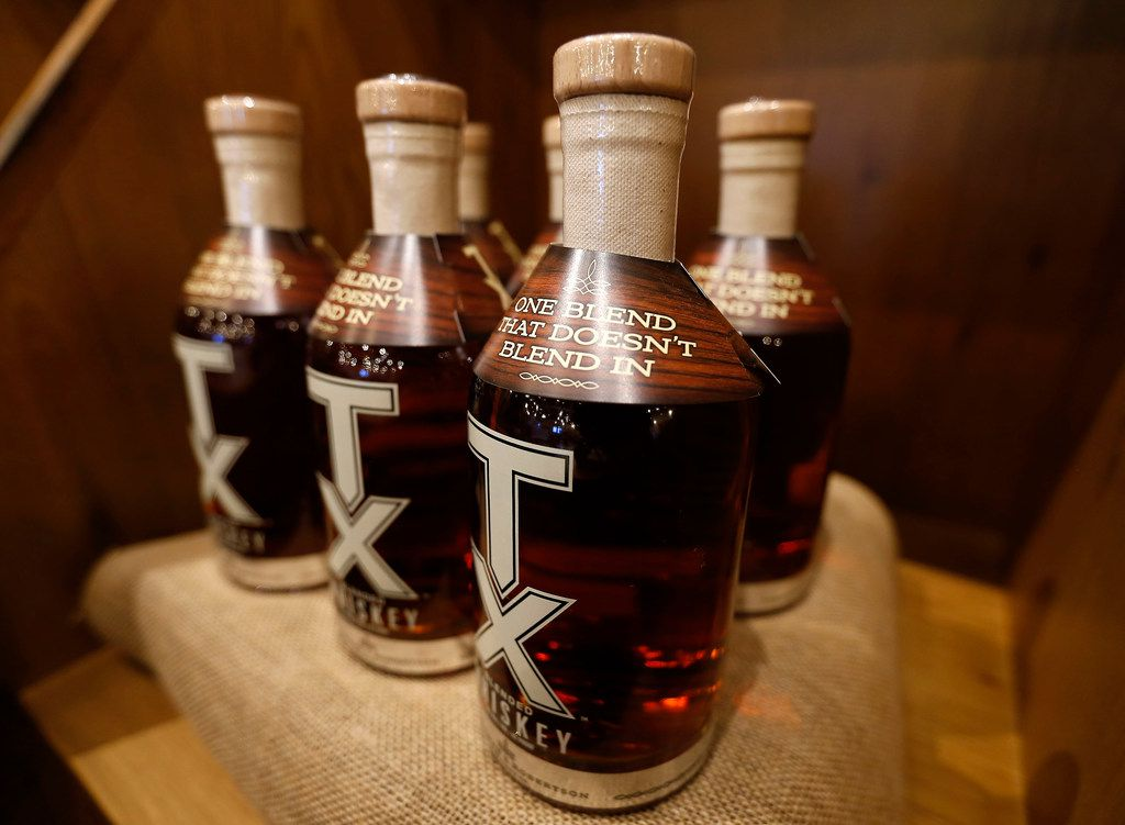 Bottles of TX Whiskey at the Ranch Store at Firestone and Robertson Distillery's Whiskey Ranch in Fort Worth.