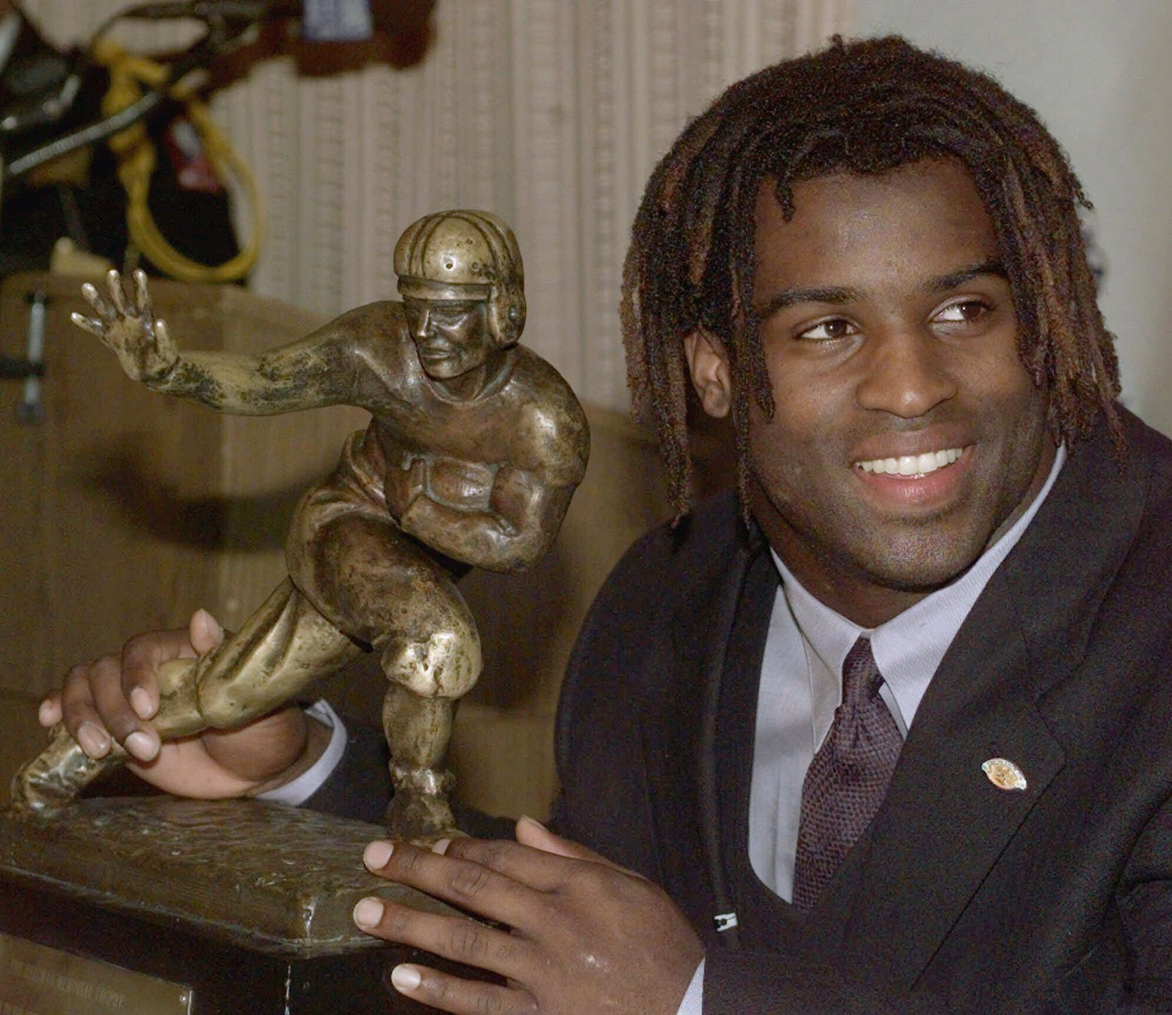 1998 - Ricky Williams (Texas connection: Texas Longhorns running back): Won the Heisman Trophy during his senior season, which happened to be the same year he became the NCAA Division I-A career rushing leader in 1998 with 6,279 yards (broken one year later by Wisconsin's Ron Dayne). Williams rushed for nine touchdowns and 385 yards in the season's first two games; rushing for 318 yards and six touchdowns against Rice; rushing for 350 yards and five touchdowns against Iowa State; and rushing for 150 yards against Nebraska's legendary Black Shirt defense. He helped beat longtime rival Oklahoma rushing for 166 rushing yards and two scores.