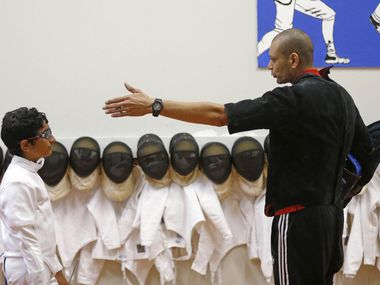 Coach Aly Khamis died from COVID-19 complications in Egypt, a friend told KXAS-TV.