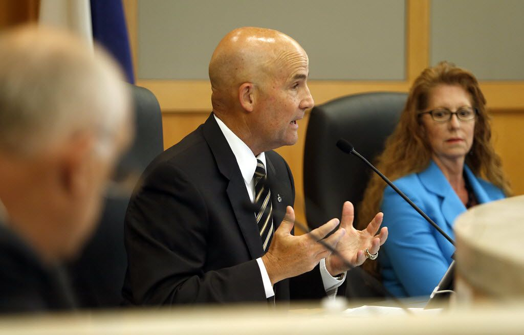 Collin County Judge Keith Self (center) speaks during a hearing at the Jack Hatchell Administration Building in McKinney on Monday, August 4, 2014.  (Stewart F. House/Special Contributor)