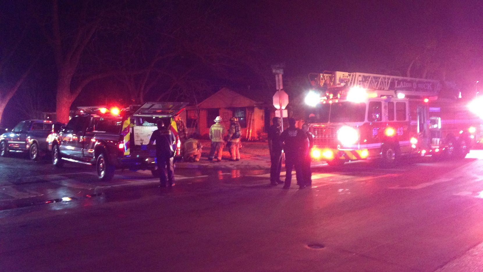 Dallas Fire-Rescue crews were battling a house fire Sunday near the site of a house explosion Friday that killed a 12-year-old girl.